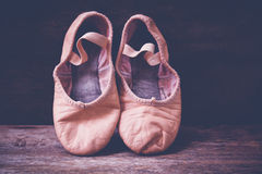 Ballet shoes on wooden floor. Royalty Free Stock Photos
