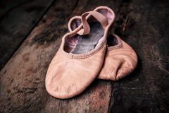 Ballet shoes on wooden floor. Royalty Free Stock Image
