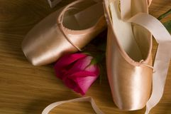 Ballet slipper - shoes with rose. New ballet slippers - shoes with rose royalty free stock photos