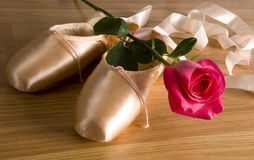 Ballet slipper - shoes with rose. New ballet slippers - shoes with rose stock photo