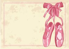 Ballet slippers background. A pair of well-worn ballet pointes shoes on old paper background Stock Photos