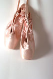 Ballet Slippers New 2. Clean, new toeshoes hanging from the wall stock photo