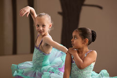Ballet Students Helping Each Other Stock Image