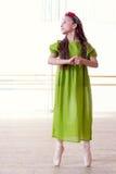 Ballet studio. Artistic ballerina posing at camera Royalty Free Stock Image
