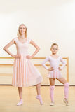 Ballet teacher and her apprentice are busy dancing Stock Photography