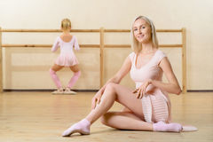 Ballet teacher and her apprentice are busy Stock Images