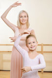Ballet teacher and her apprentice are holding a Royalty Free Stock Images