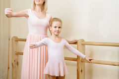Ballet teacher and her apprentice are holding a Royalty Free Stock Photo