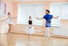 Ballet teacher and young students Royalty Free Stock Photography