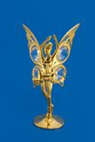Ballet theme. Picture of a golden figurine isolated on blue Royalty Free Stock Photo