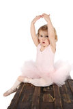 Ballet toddler. Little ballet girl wearing a pink tutu on an antique trunk Royalty Free Stock Photography