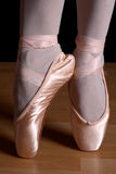 Ballet toes. Ballerina with ballet shoes standing with pointed toes Stock Photos