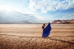 Ballet under the blazing sun. Ballerina is dancing in the desert under the blazing sun stock photo