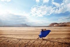 Ballet under the blazing sun. Ballerina is dancing in the desert under the blazing sun stock image