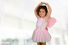 Ballet. Young girl standing in a nice ballet dress Royalty Free Stock Image