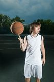 Ballhandling skills showcase. Streetball player showing his skills with the ball Stock Images