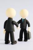 Ballhead handshake on white background4 Royalty Free Stock Photo