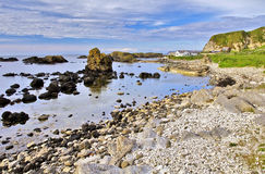 Ballintoy Harbour set in the Rocky Antrim Coastline. Antrim County, Northern Ireland. The Antrim Coast is one of the most popular destinations in Northern royalty free stock images
