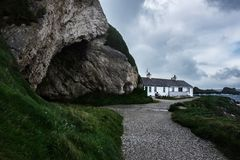 A cave at Ballintoy Harbour, Northern Ireland. Ballintoy Harbour and Village are located alongside the B15 coast road, 17 miles north-east of Coleraine and five royalty free stock images