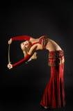 Ballo biondo della donna con il saber Fotografia Stock