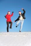 Ballo delle coppie sulla collina della neve Immagine Stock