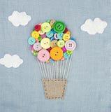 Ballon à air chaud fait de buttons1 multicolore Photo stock