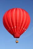 Ballon à air d'un rouge ardent Image libre de droits