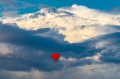 Ballon à air d'un rouge ardent Photographie stock