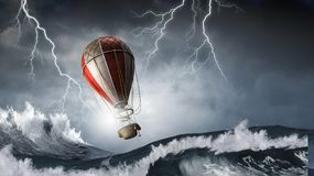 Ballon à air dans la tempête Photo stock