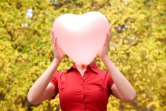 Ballon. Portrait of beautiful woman holding ballon in form heart royalty free stock images