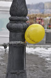 Ballon attached with metal chain to pillar. Royalty Free Stock Photos