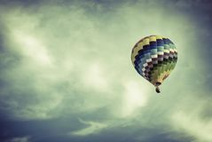 Ballon in a cloudy sky with vintage colors. Effect stock images