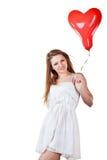 Ballon de coeur de fixation de femme d'amour Photo stock