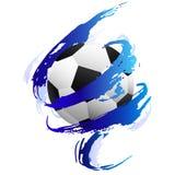 Ballon de football à l'intérieur des calomnies bleues de peinture images stock