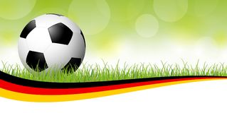ballon de football avec la bannière allemande Photos libres de droits
