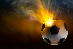 Ballon de football avec la flamme Photographie stock
