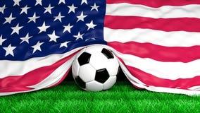 Ballon de football avec le drapeau des Etats-Unis sur le terrain de football Photos stock