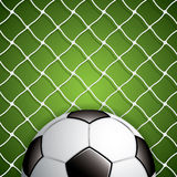 Ballon de football dans le filet Photographie stock