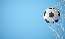 Ballon de football dans le réseau Image stock