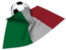 Ballon de football et drapeau de l'Italie Images stock