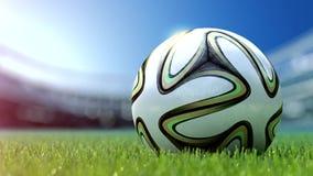 Ballon de football moderne dans l'herbe rendu 3d Photo libre de droits