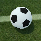 Ballon de football sur l'herbe Photo libre de droits
