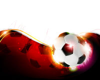 Ballon de football sur le fond rouge onduleux Photos libres de droits