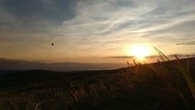 Ballon im Sonnenuntergang Stockfotografie