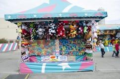 Ballon pop spel bij de markt van de Staat van Oklahoma Stock Foto
