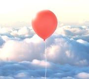 Ballon rouge en nuages Images stock