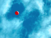 Ballon In Sky. Portrait of a single red ballon in blue sky stock photography