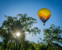 Ballon and Sun. Hot air baloons at a baloon festival in Vermont Stock Image