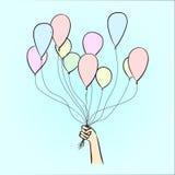 Ballone in der Hand Stockfoto