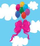 Ballone mit einem Bogen in den Wolken. Stockbild